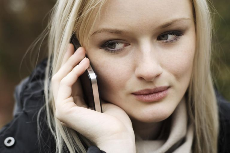 woman checking her voicemail